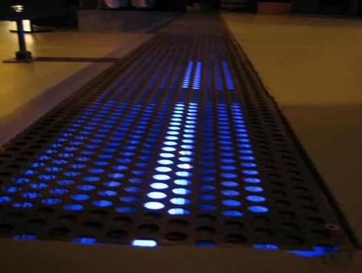 Walking perforated sheet, neon integrated