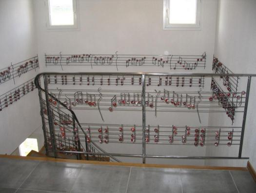 Details ... The musical score is decorated wall, runs around the stairwell